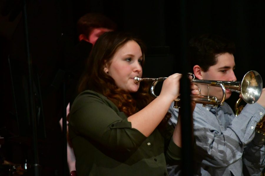 Dilynn Everitt (left) and Ethan Shattuck (right) perfectly play their trumpets during the performance.