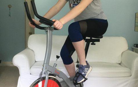 Korah Honig does a workout on a stationary bike.