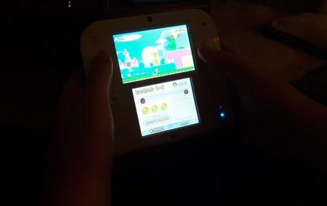 A student enjoys Super Mario Bros.