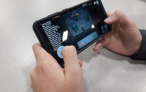 A student enjoys playing Among Us.