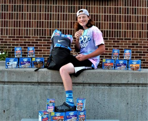 Logan Koutz takes Pop-Tarts-themed pictures in front of St. Louis High School.