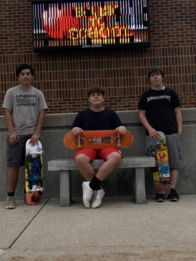 St. Louis students are taking up skateboarding. From left to right: Riley Davis, Landon Gall, and Logan Antio.