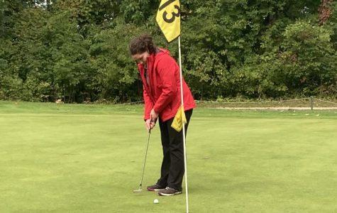 Danielle Thelen lines up a putt.