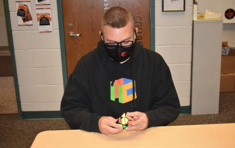Colton Markwell solves a Rubik's Cube.