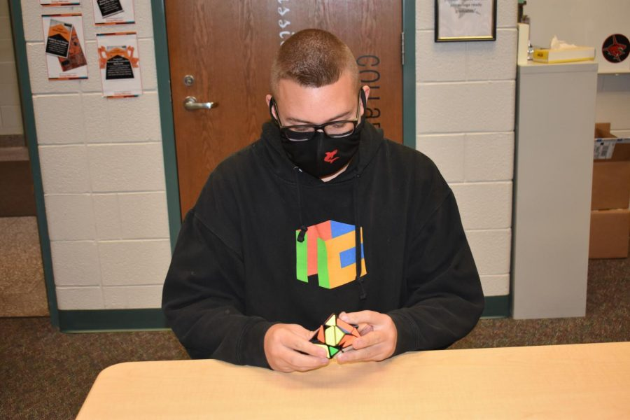 Colton Markwell solves a Rubiks Cube.