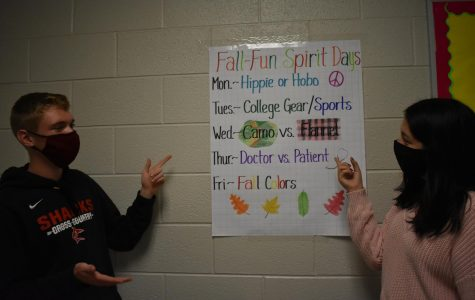 Keegan Honig (left) and Maria Puga-Trevino (right) discuss the spirit day themes.