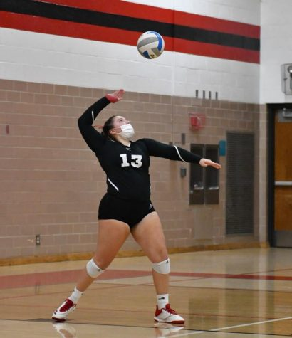 Senior Delainee Zacharko serves the ball. Zacharko has been apart of the St. Louis volleyball program all four years of high school.