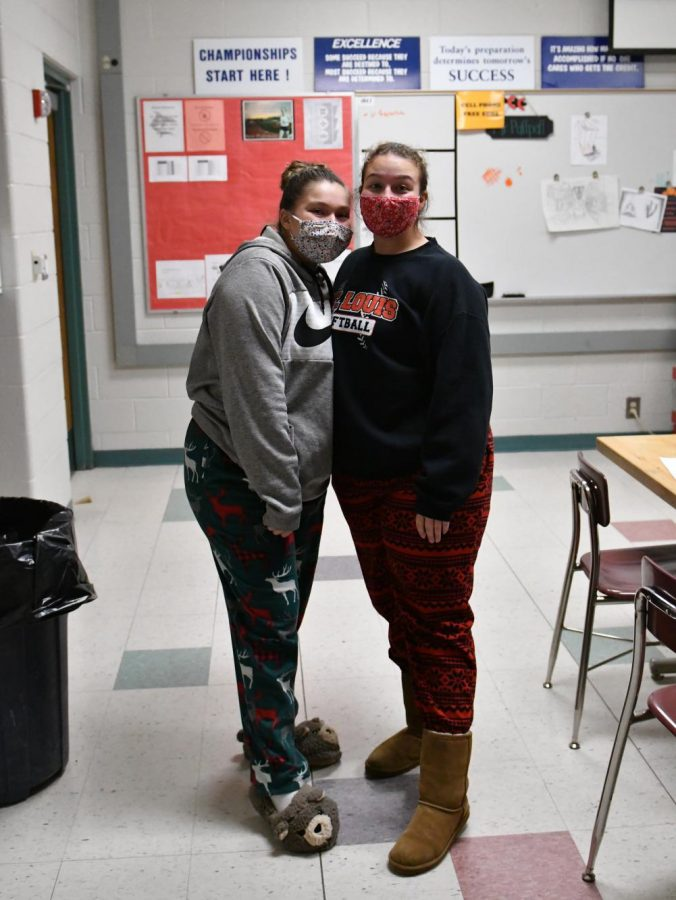 Delainee Zacharko and Macie Salladay participate in Pajama Day.