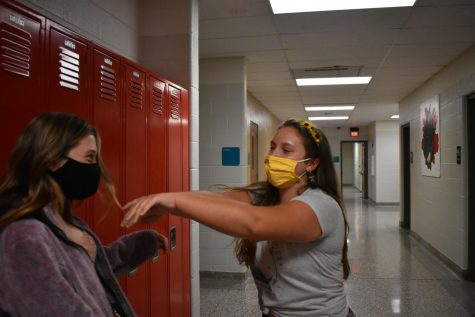 Senior, Dilynn Everitt (right) shoving Junior, Samantha Burt (left) into a locker
