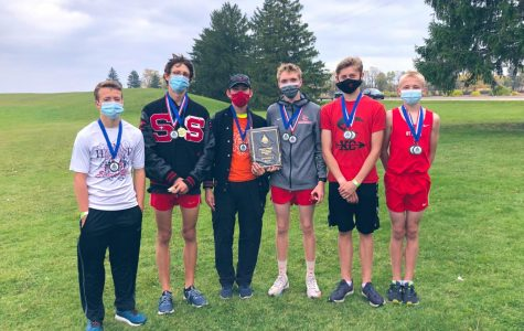 The boys' varsity team captured a win at the Greater Lansing Invitational and earned a plaque.