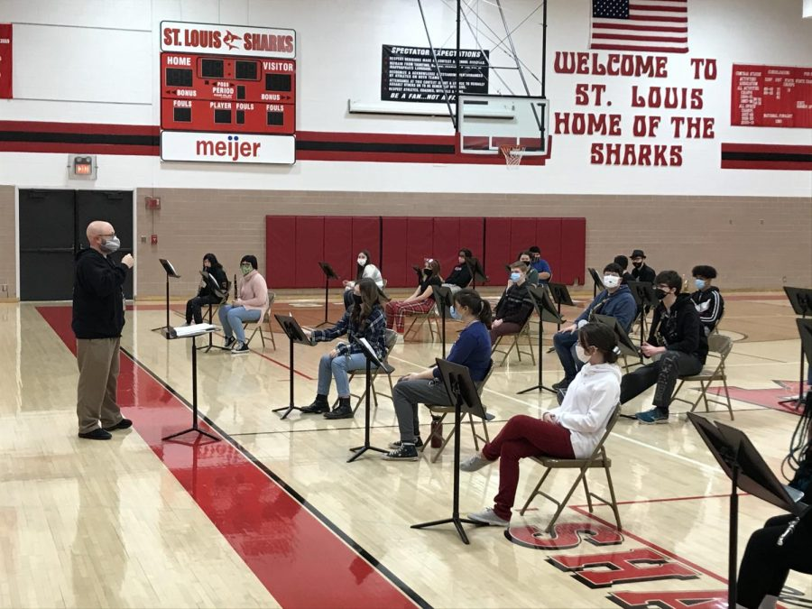 SLHS band plays their music piece in the gymnasium.