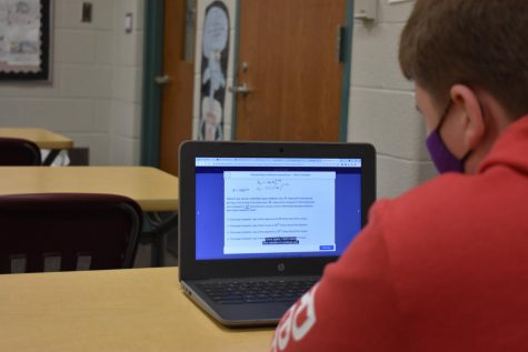 A student practices for the SAT by utilizing Khan Academy.