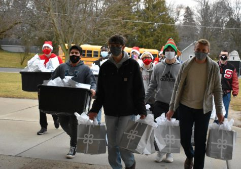 St. Louis High School woodshop students bring the toys to Carrie Knause Elementary.