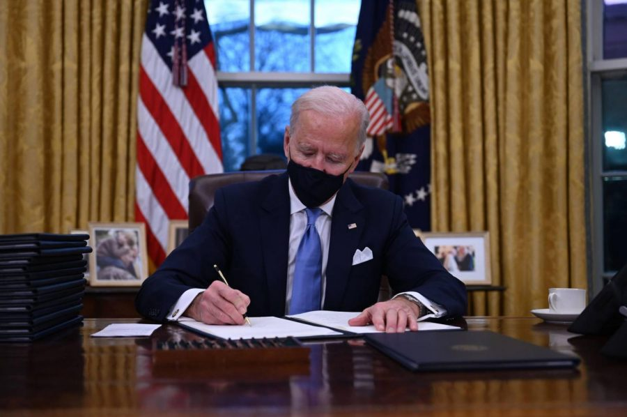 Joe Biden signs executive orders his first day in office.