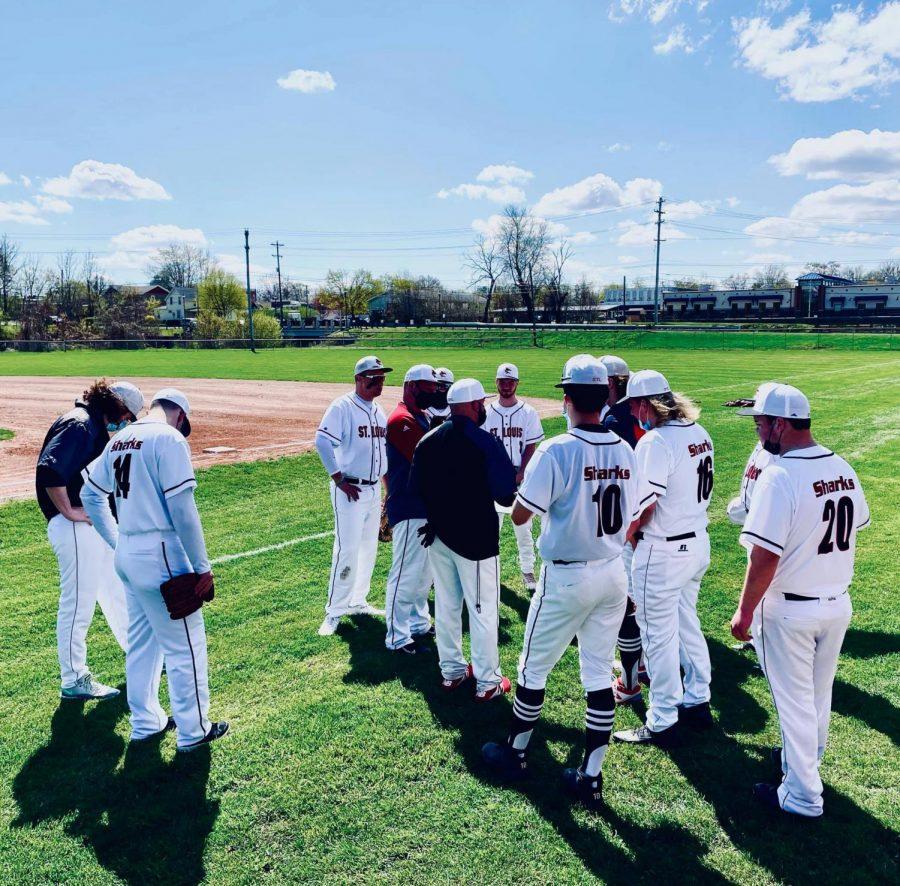 STL Varsity baseball gathers around for a group talk.