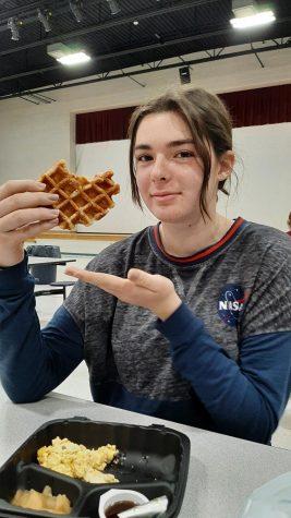 Junior Korah Honig enjoys the Belgium waffles on the lunch menu.