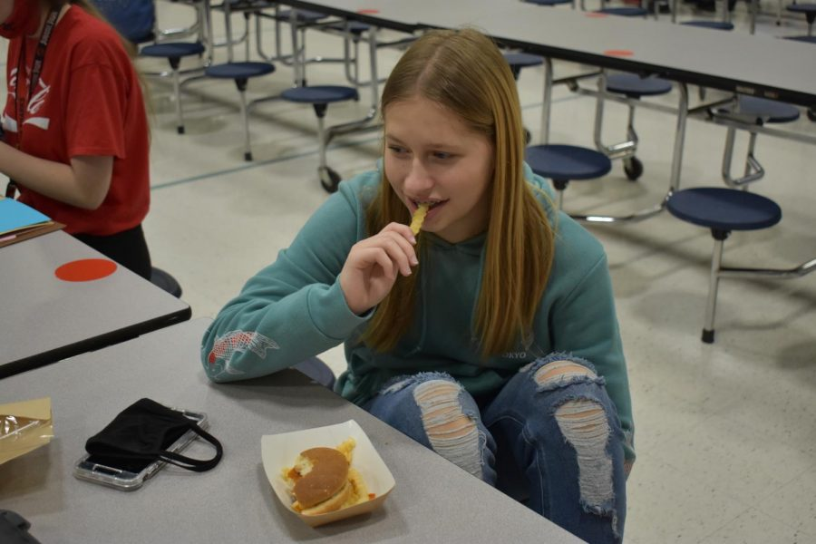 SLHS student enjoys the school lunch fries on the menu.