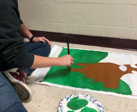 SLHS student paints a picture.