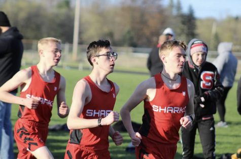 From left to right: Ben March, Joe Erickson, and Keegan Honig compete in the 3200-meter race.
