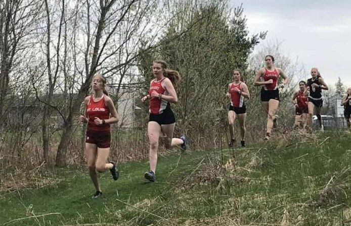 Mikaila Borie (left) leads a pack.