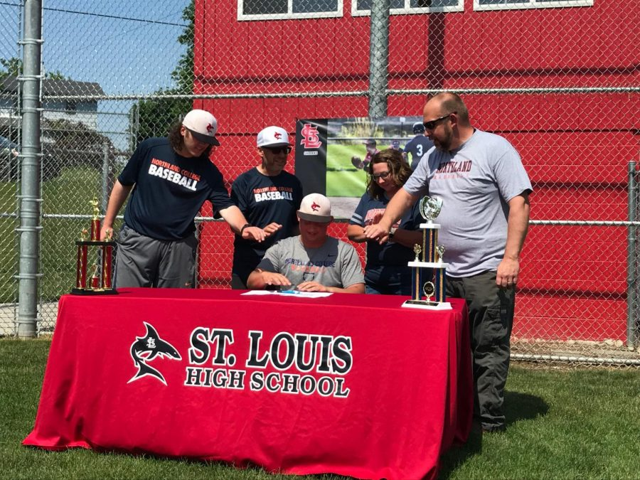 Luke Maxwell signed for Northland College with his father by his side.