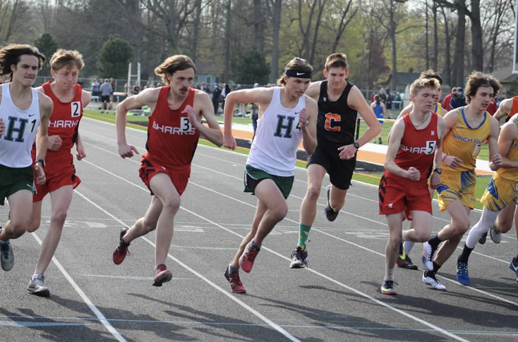 St. Louis runners Nate March (left), Aaron Bowerman (middle), and Keegan Honig (right) get out fast at the start of the 1600-meter race.