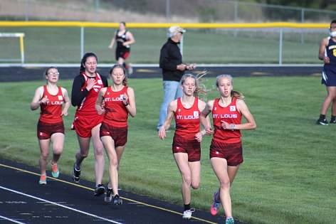 Boys' and girls' St. Louis track teams ran on the Standish-Sterling track.