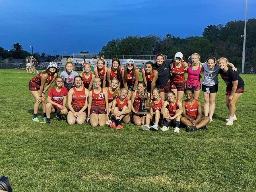 St. Louis girls' track team celebrating after regional championship.
