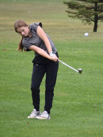 Sophmore Josie Schrot swings for the green