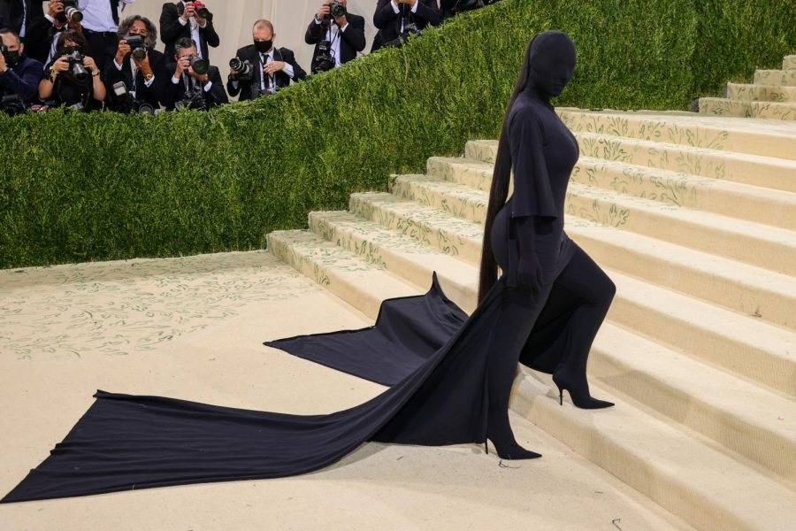 Kim Kardashian walks the run away of the Met Gala in her all black outfit.