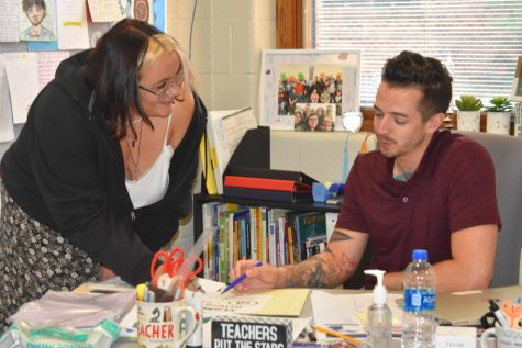 Mr. Miller sits down with a student to help them on their work!