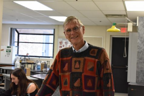 Mr. Taylor poses for a photo in one of his well-loved sweaters!