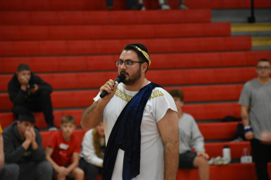 Mr. Bernia announces the winners of capture the flag while in his Ancient Greece  costume.
