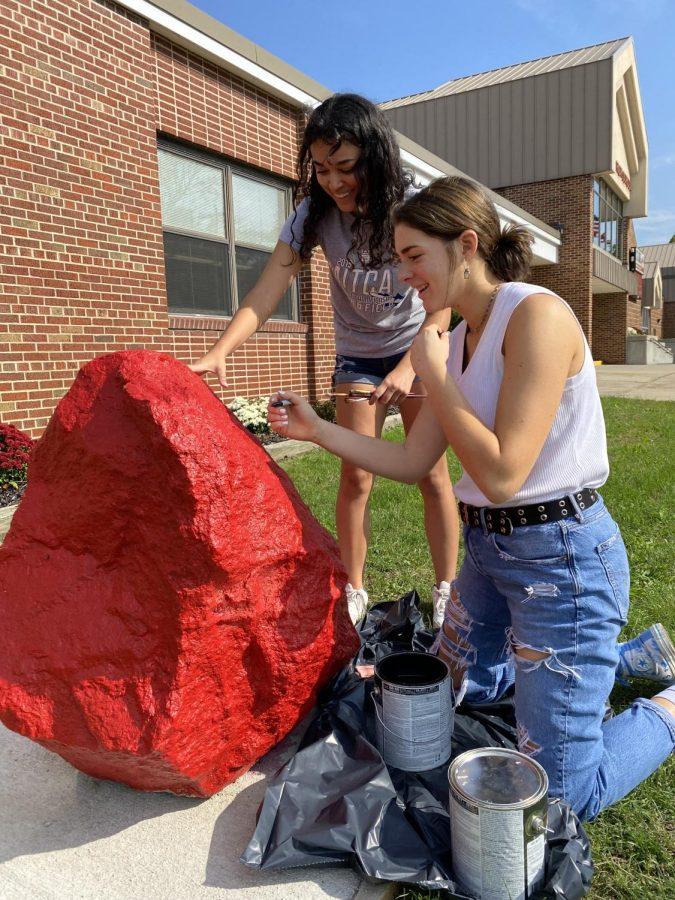Seniors Adry Munoz and Korah Honig spend their afternoon painting the spirit rock.
