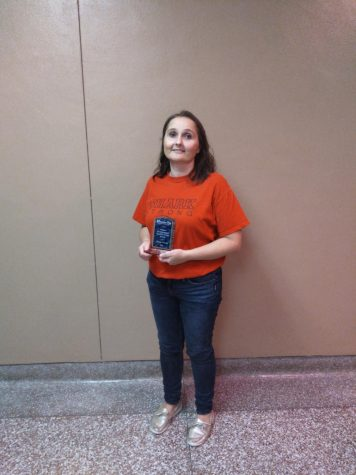 Ms. Everitt poses with her  CFX teacher of the week  award.