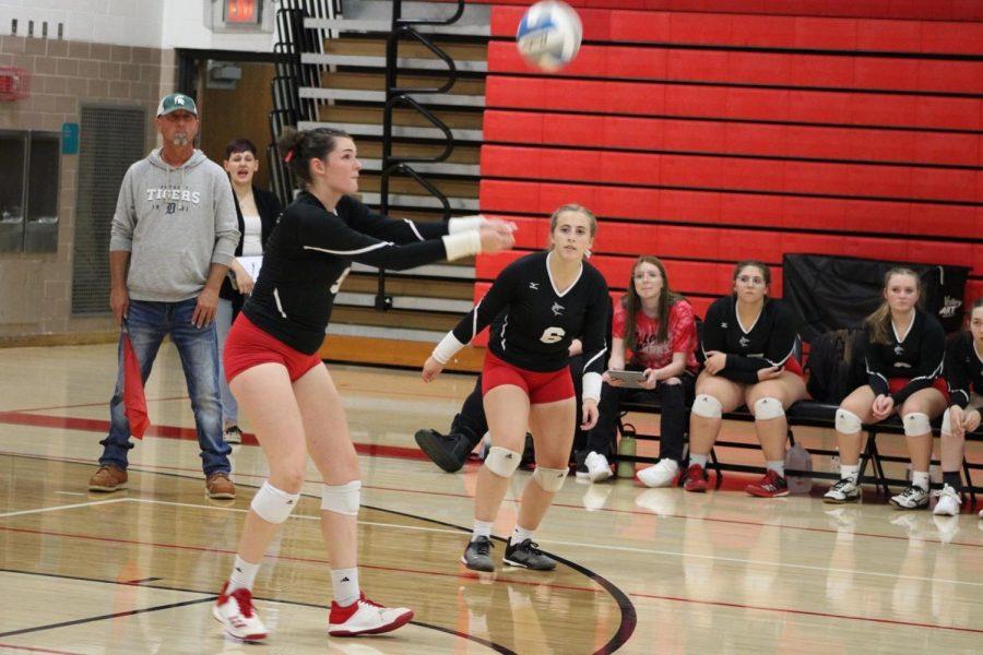 Senior Korah Honig hits volleyball towards the competition