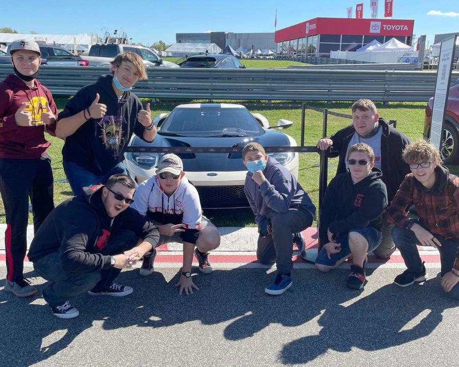 Sharks IVD poses in front of premier car at Pontiac Motor Bella